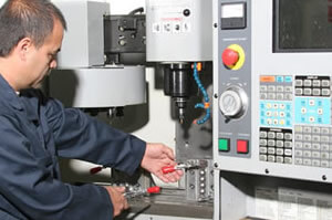 Man Working CNC Machining Mill